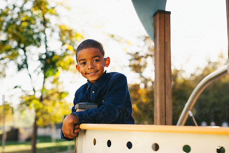 Portrait of a 5 years old boy at the playground. by BONNINSTUDIO for Stocksy United