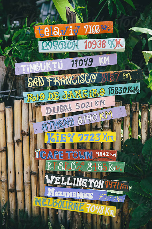 Crossroad signs. Travel destinations by Andrey Pavlov for Stocksy United