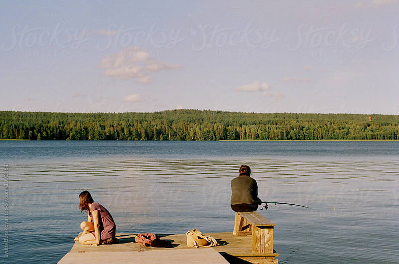Man and woman fishing  by Lyuba Burakova for Stocksy United