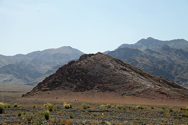 The rugged rocky mountains of Balochistan by Yasir Nisar for Stocksy United