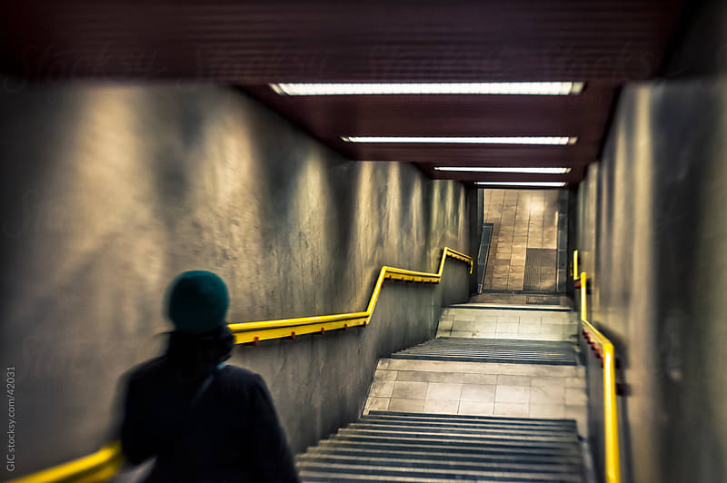 Person walking in subway tunnel by GIC for Stocksy United