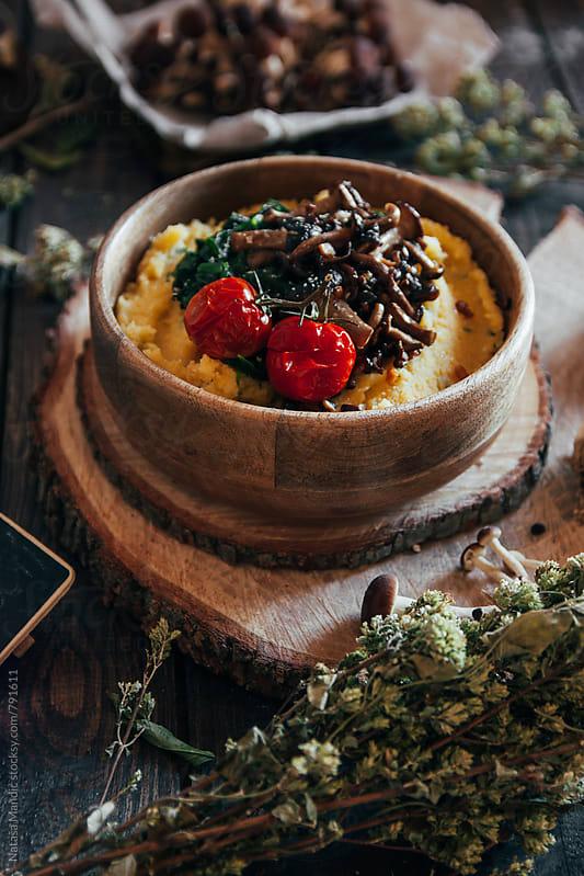 Polenta with mushrooms and roasted tomatoes by Nataša Mandić for Stocksy United