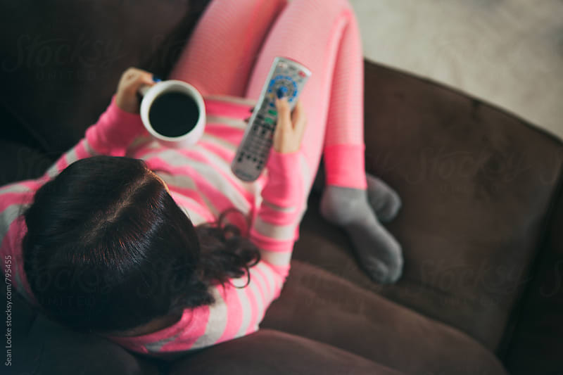 Pajamas: Having Cup Of Coffee While Watching Television by Sean Locke for Stocksy United