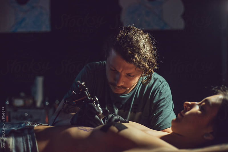 Artist Making Tattoo by Lumina for Stocksy United