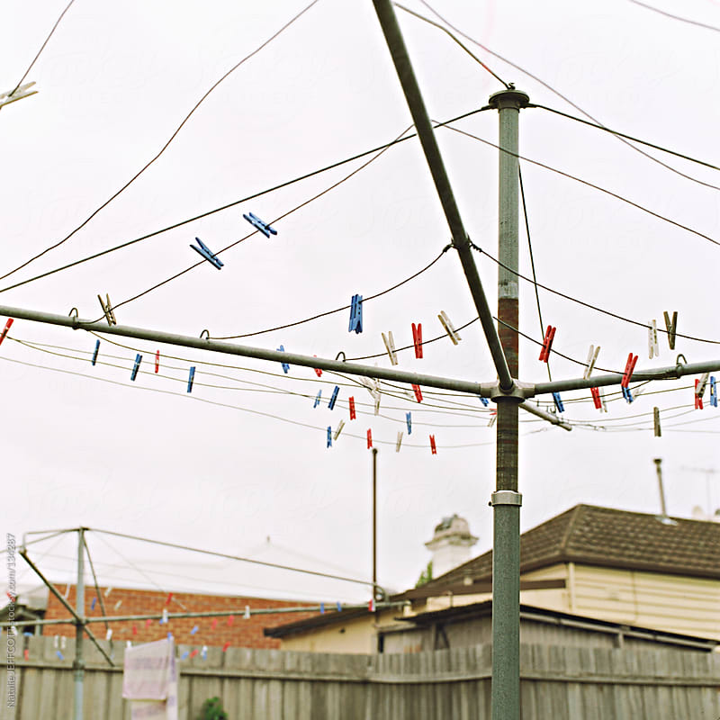 empty clothes line in suburban backyard in Melbourne, Australia by Natalie JEFFCOTT for Stocksy United