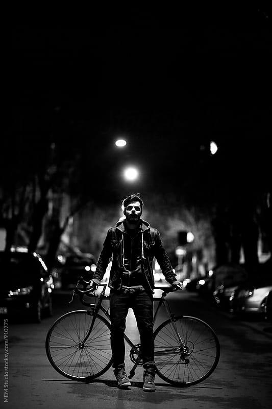 Cyclist by night by MEM Studio for Stocksy United