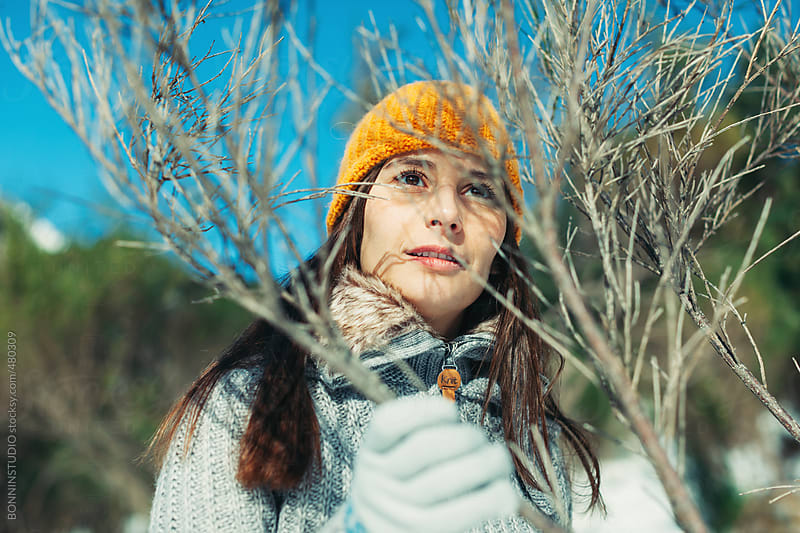 Portrait of a young woman wearing winter clothes on a mountain. by BONNINSTUDIO for Stocksy United