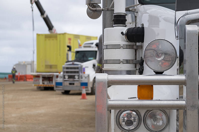 Close up of semi-trailer at construction site by Rowena Naylor for Stocksy United
