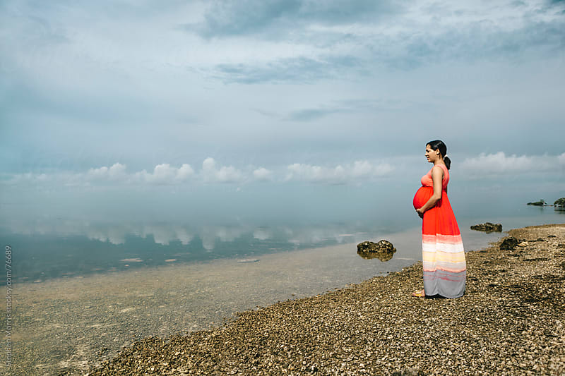 Pregnant Woman Looking out to Sea by Stephen Morris for Stocksy United