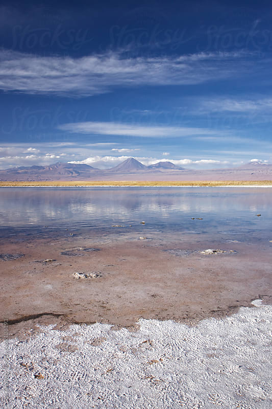 Atacama landscape with salt flat and volcano by Jon Attaway for Stocksy United
