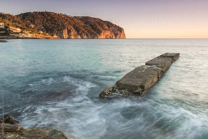 Stone pier on the coast of Mallorca by Marilar Irastorza for Stocksy United