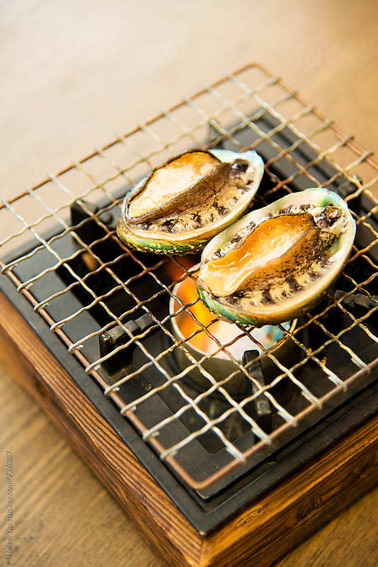 barbeque abalone by Helen Yin for Stocksy United