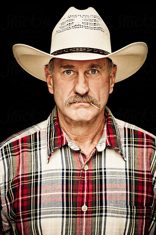 Cowboy Portrait by Geoffrey Hammond for Stocksy United