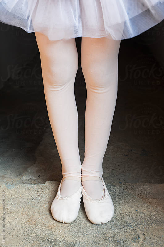 Little ballerina resting before a rehearsal by Bisual Studio for Stocksy United