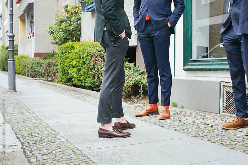 Men's Fashion - Legs of Three Men in Suit Standing on City Sidewalk by Julien L. Balmer for Stocksy United