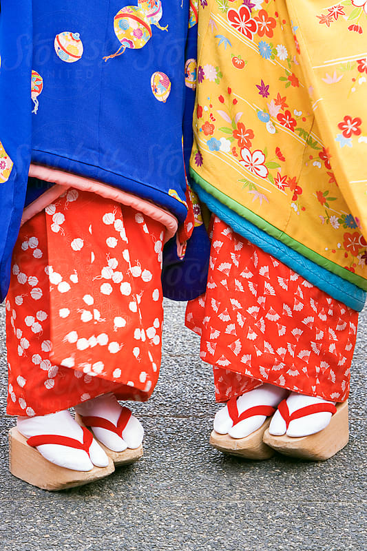 Asia, Japan, Honshu, Kansai Region, Kyoto, detail of two Geisha's - low angle detail of Kimono and Geta (high wooden shoes) by Gavin Hellier for Stocksy United