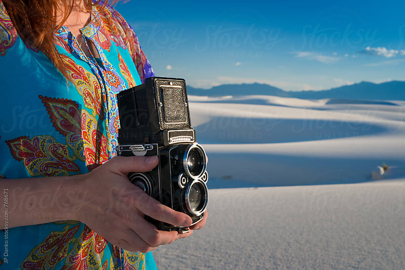 Woman Photographer at White Sands National Monument New Mexico Holding Vintage TLR Film Camera by JP Danko for Stocksy United