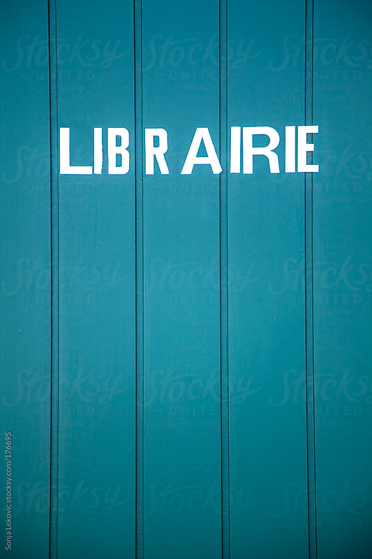 library sign in french on blue wooden door by Sonja Lekovic for Stocksy United