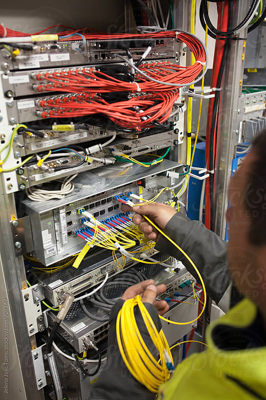 Working with optic fibre cables. by Jelena Jojic Tomic for Stocksy United