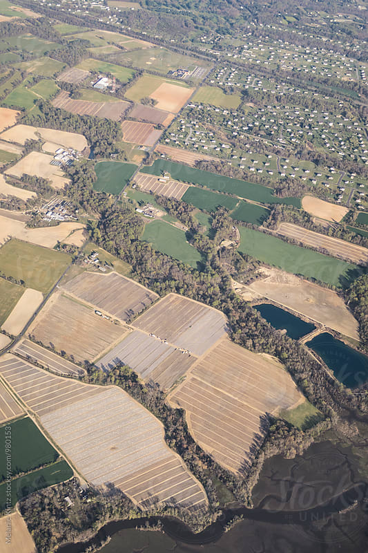 Fields and settlements seen from an airplane by Melanie Kintz for Stocksy United