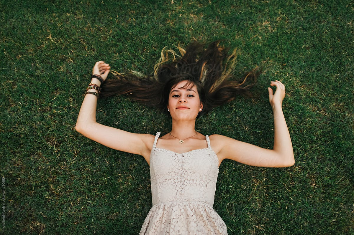 Girl Laying In Grass