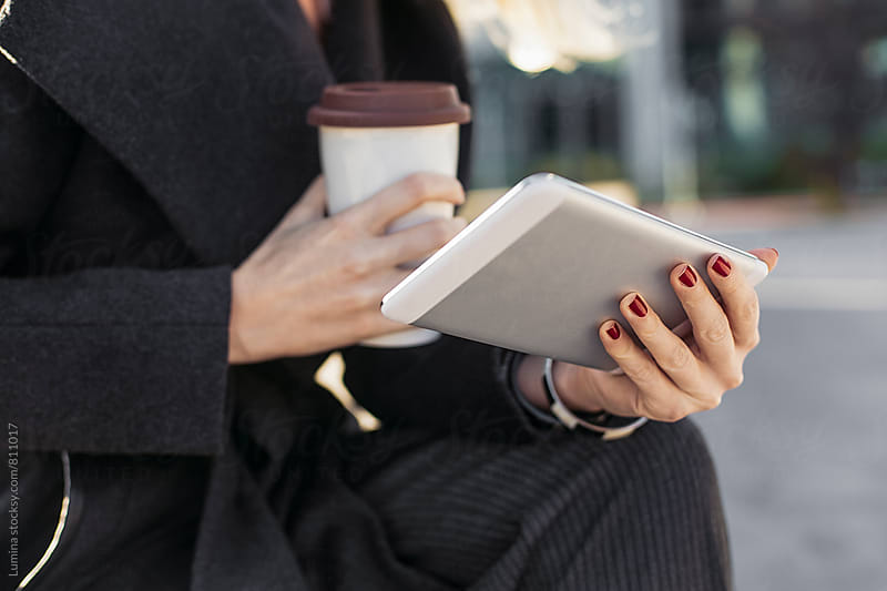 Hands of a Woman Holding a Tablet by Lumina for Stocksy United
