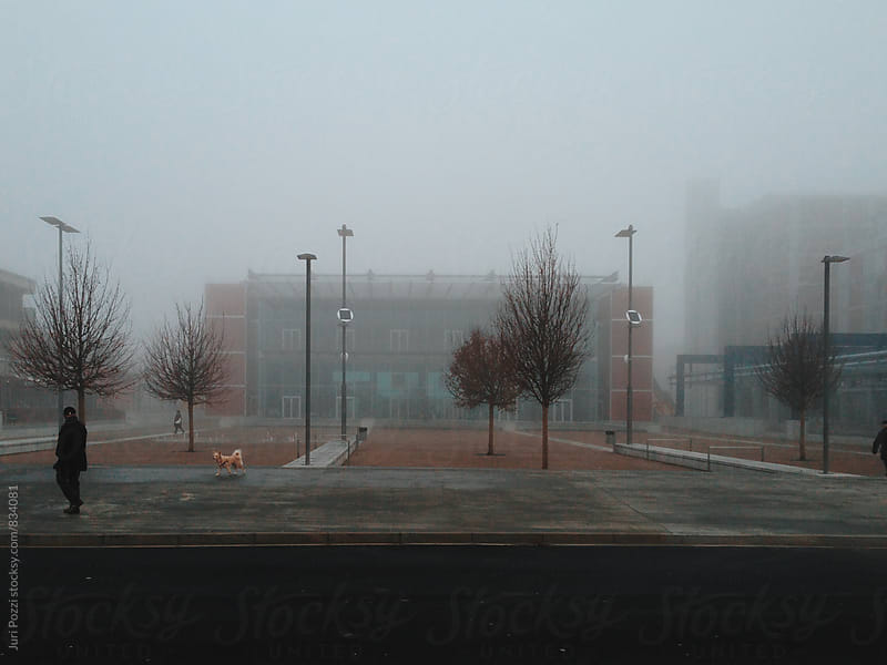 foggy day in a modern town by Juri Pozzi for Stocksy United