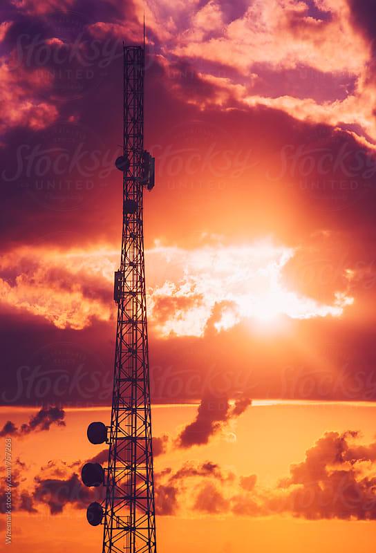Telecommunication tower during dramatic sunrise  by Srdjan Kirtic for Stocksy United