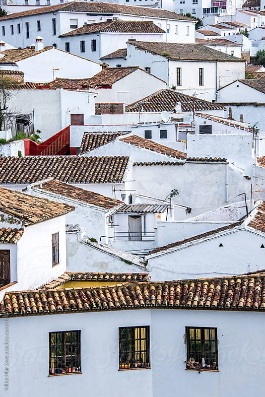 Vertical shot of white walled houses in Spain. by Mike Marlowe for Stocksy United