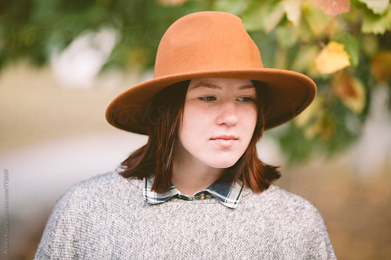 autumn portrait of young woman with wool hat . by Alexey Kuzma for Stocksy United