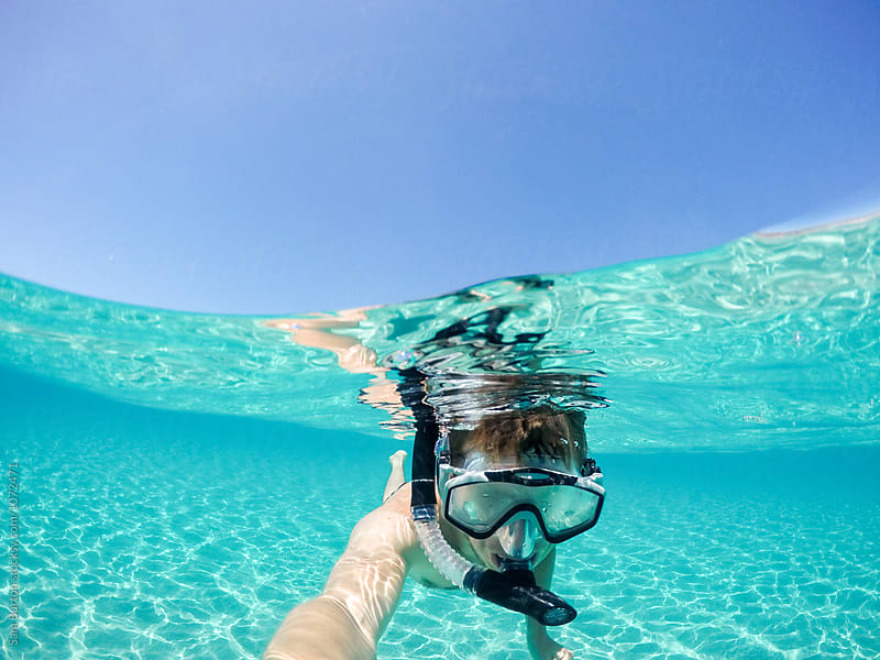 Young man snorkelling in clear water in Malta by Sam Burton for Stocksy United