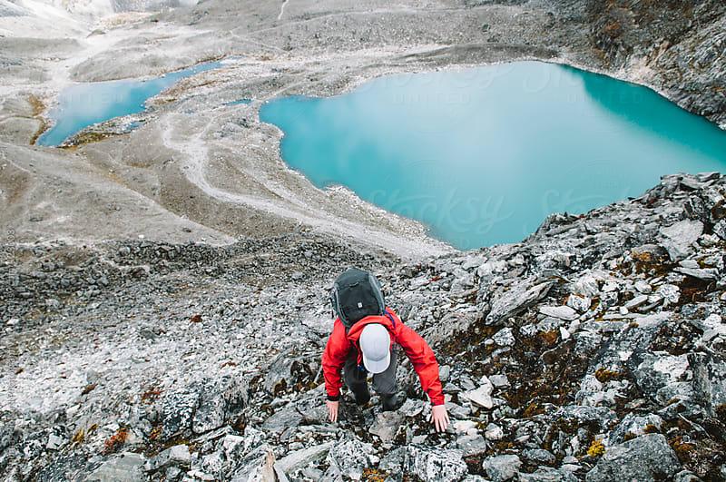 Female trekker negotiating rocky terrain, Everest Region, Sagarmatha National Park, Nepal. by Thomas Pickard for Stocksy United