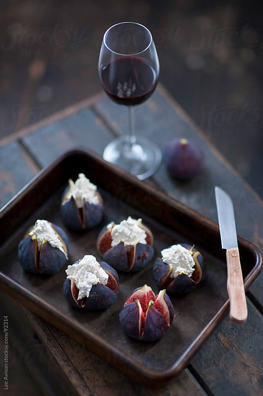 fresh figs and mascarpone cheese by Lee Avison for Stocksy United