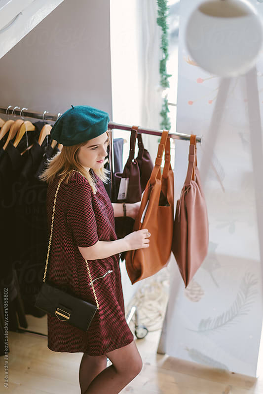 Woman Looking at Bags in the Store  by Aleksandra Jankovic for Stocksy United