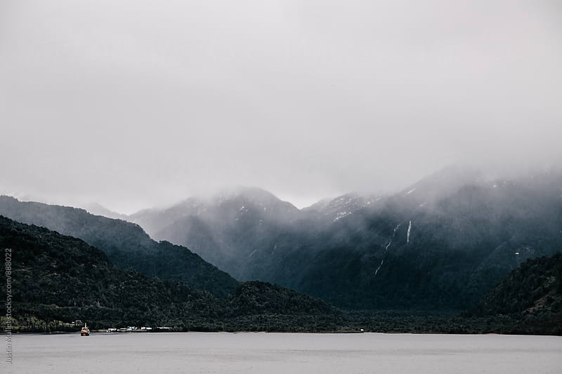 A cloudy wet day at Port Chacabuco, Chile by Justin Mullet for Stocksy United