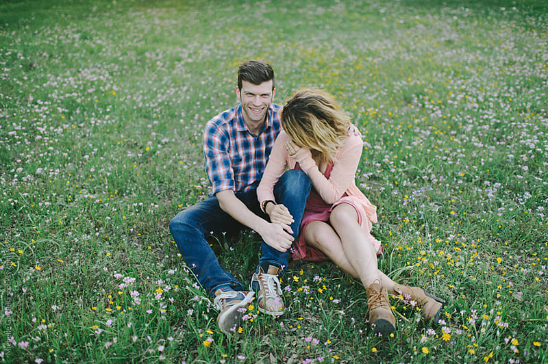 Couple in Wildflowers  by Michelle Gardella for Stocksy United