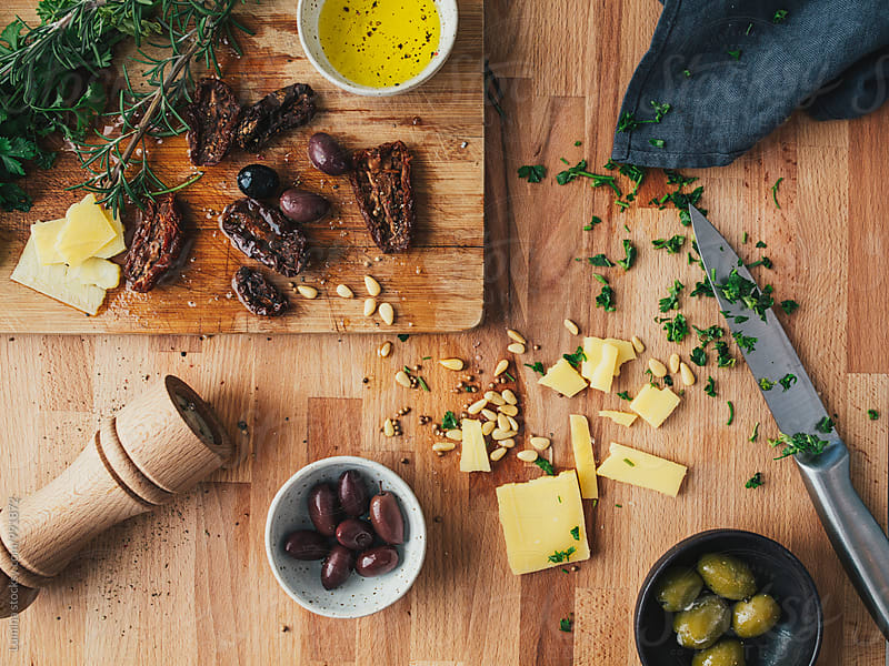 Olives, Cheese, Parsley and Rosemary by Lumina for Stocksy United