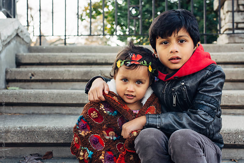 Cute brother and sister sitting on steps by Gabriel (Gabi) Bucataru for Stocksy United