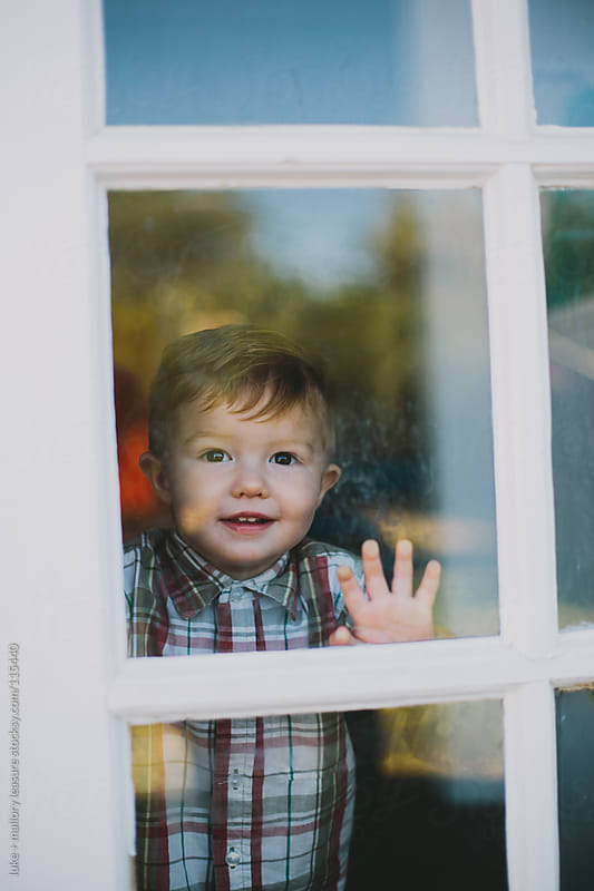 Toddler Looking through window by luke + mallory leasure for Stocksy United
