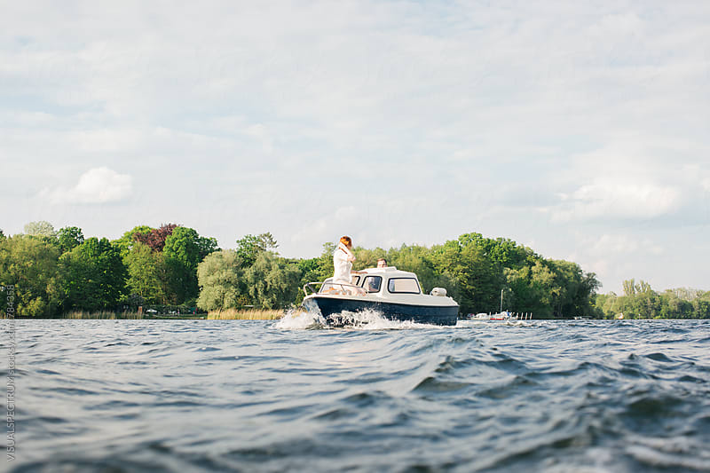 Caucasian Couple on Small Motorboat on Sunny Afternoon by VISUALSPECTRUM for Stocksy United