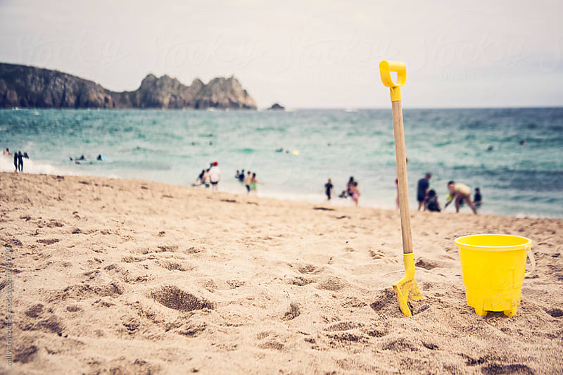 Bucket and spade on the beach by sally anscombe for Stocksy United