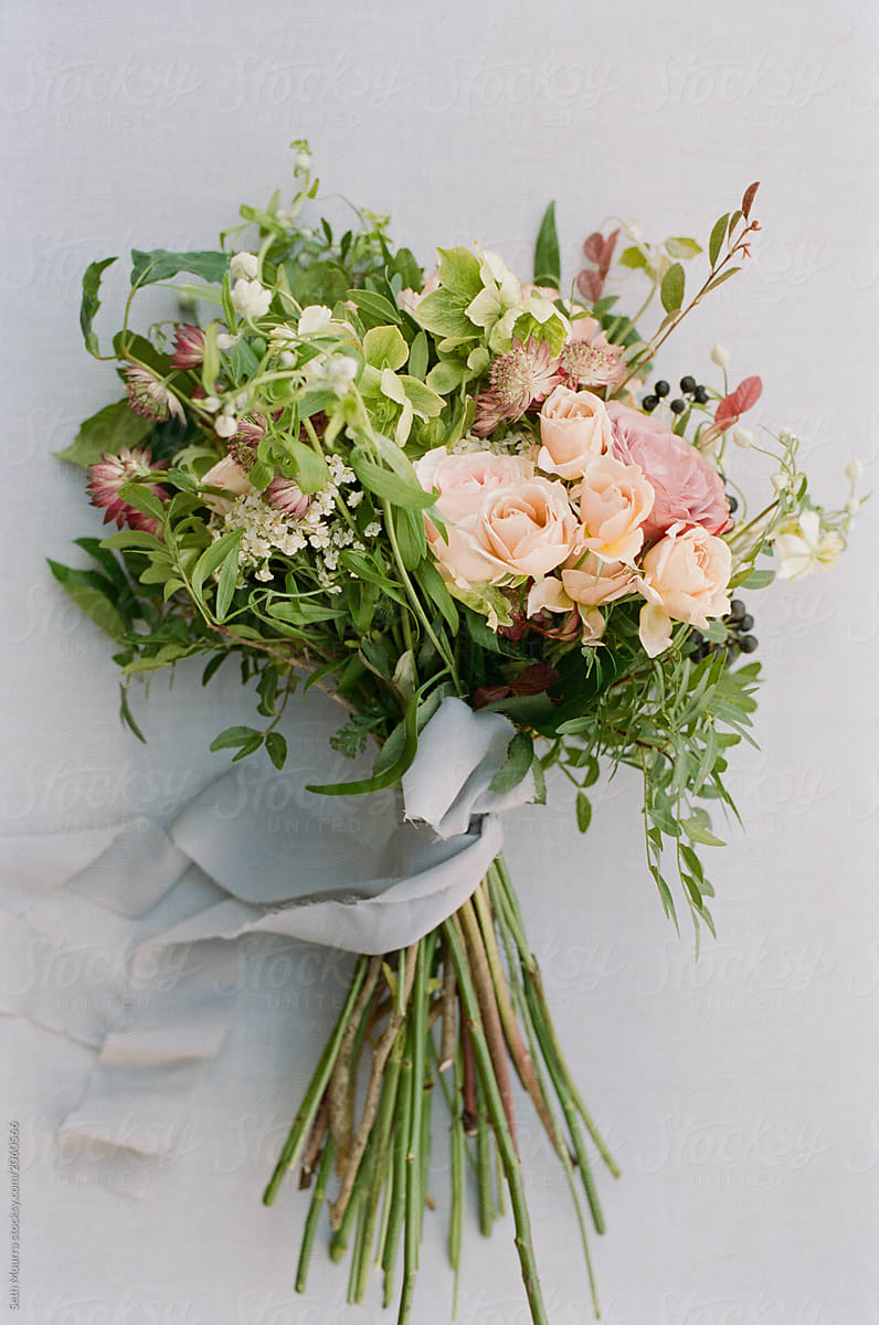 Overgrown Wildflower Bouquet With Grey Silk Ribbon Against A Grey Linen Backdrop By Seth Mourra Bouquet Wedding Stocksy United