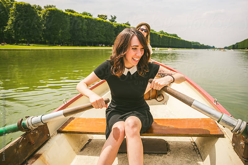 woman rowing  by Sam Hurd Photography for Stocksy United