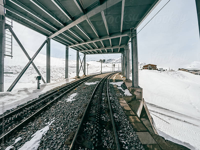Driver view of train crossing snow mountain by Maa Hoo for Stocksy United
