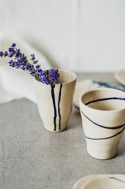 Artistic mugs and plates with lavender by Tatjana Zlatkovic for Stocksy United