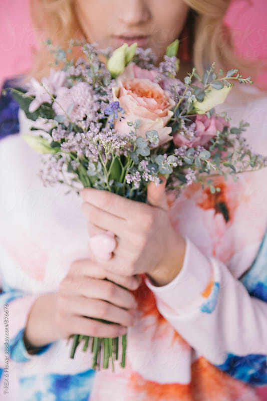 Close-up of woman holding bouquet of wildflowers by Danil Nevsky for Stocksy United
