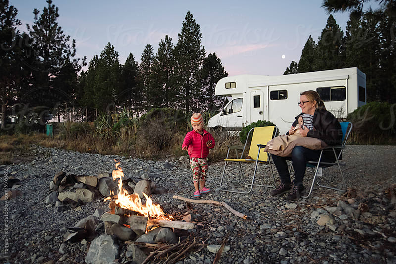 Girl toddler, mother and infant boy, camping on Lake Pukaki, near Aoraki / Mt Cook National Park, New Zealand. by Thomas Pickard for Stocksy United