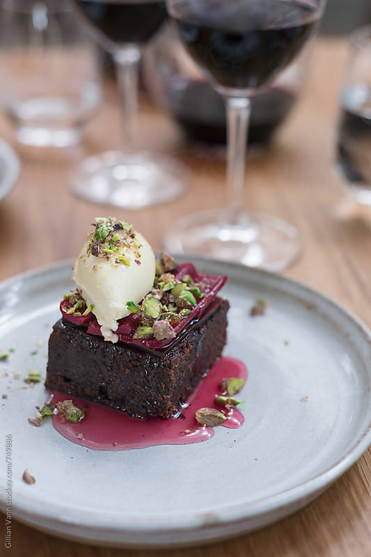 chocolate brownie with rhubarb and pistachio by Gillian Vann for Stocksy United