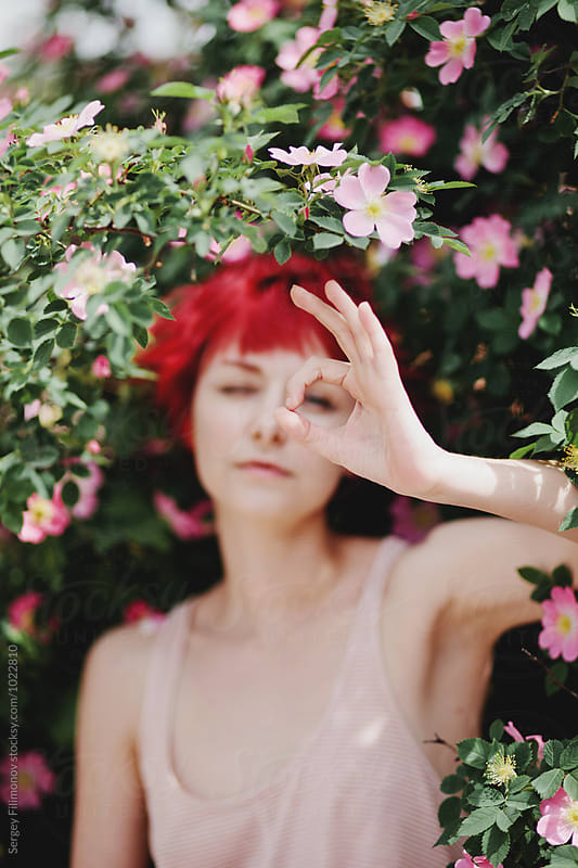 Red-haired girl showing OK sign with his hand by Sergey Filimonov for Stocksy United