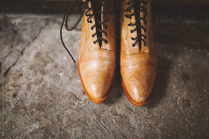 rustic leather boots by Nate & Amanda Howard for Stocksy United